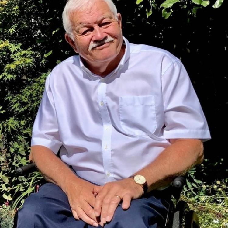 Portrait of Dr Phil Friend OBE.