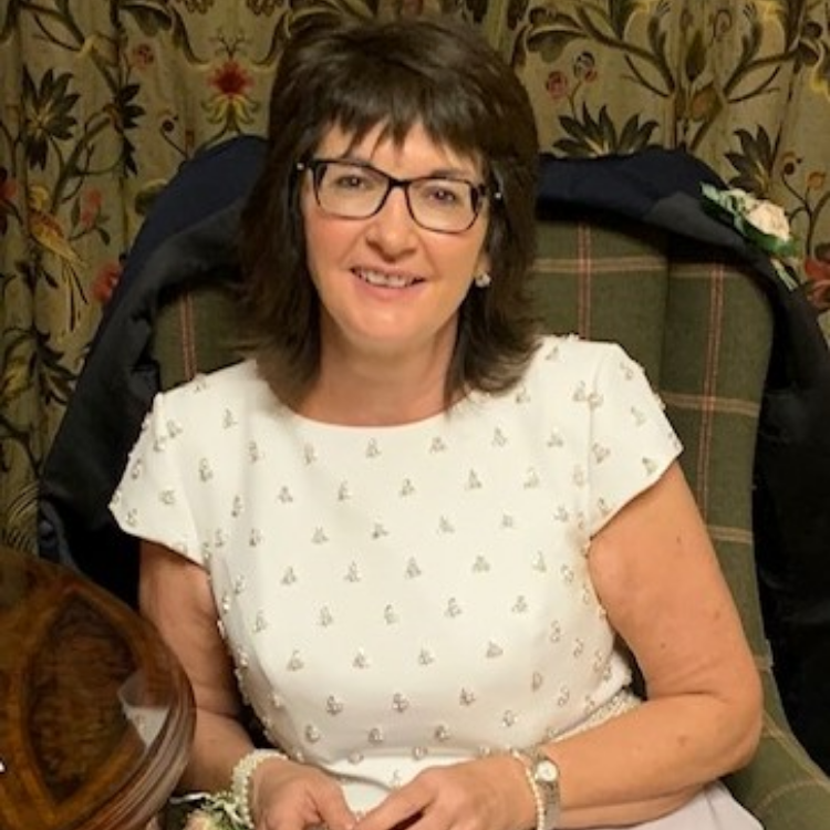 Portrait of Sandra Adair MBE.
