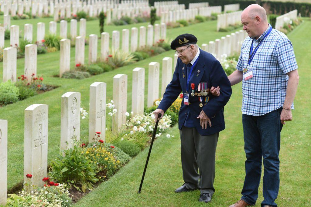 Military Veteran Albert Holmshaw with Taxi Charity Volunteer Danny Shelton visit a memorial
