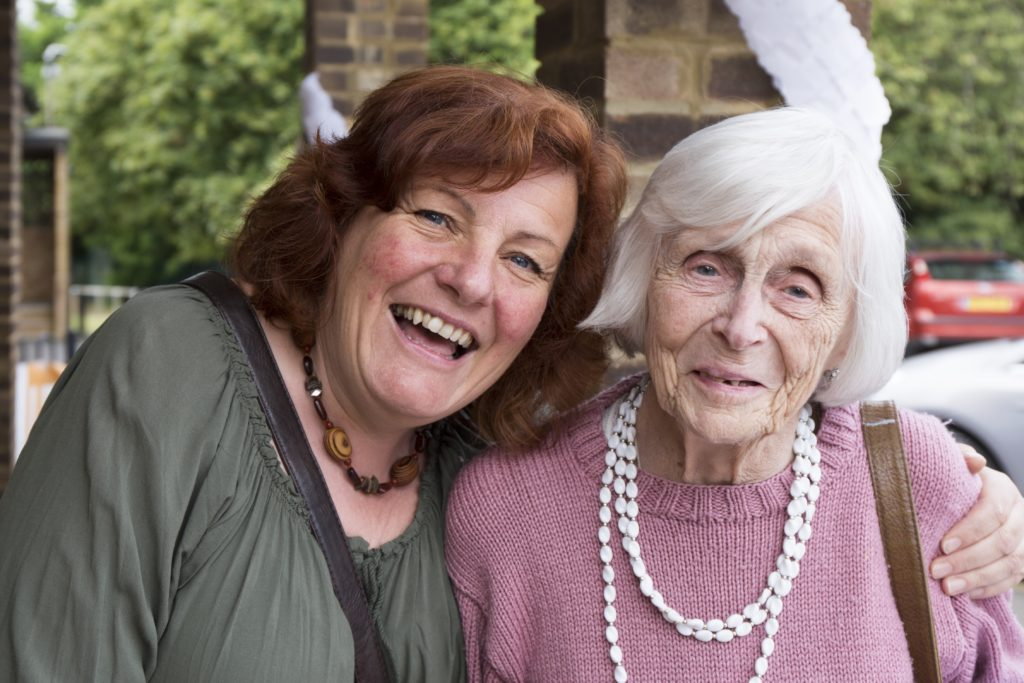 Two ladies smiling for a photo