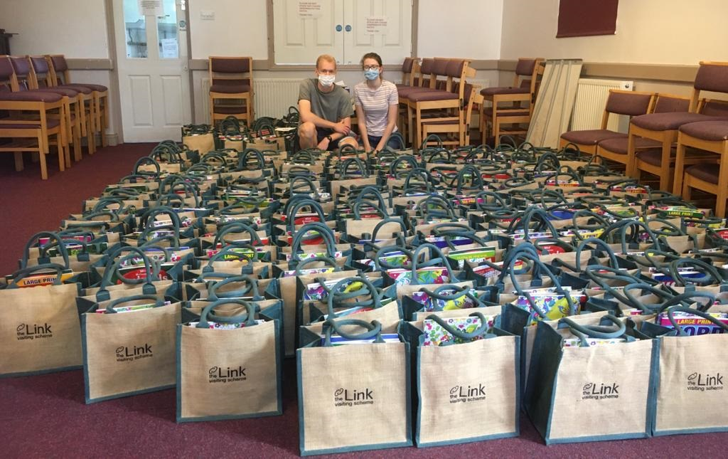 A large number of care bags in a room