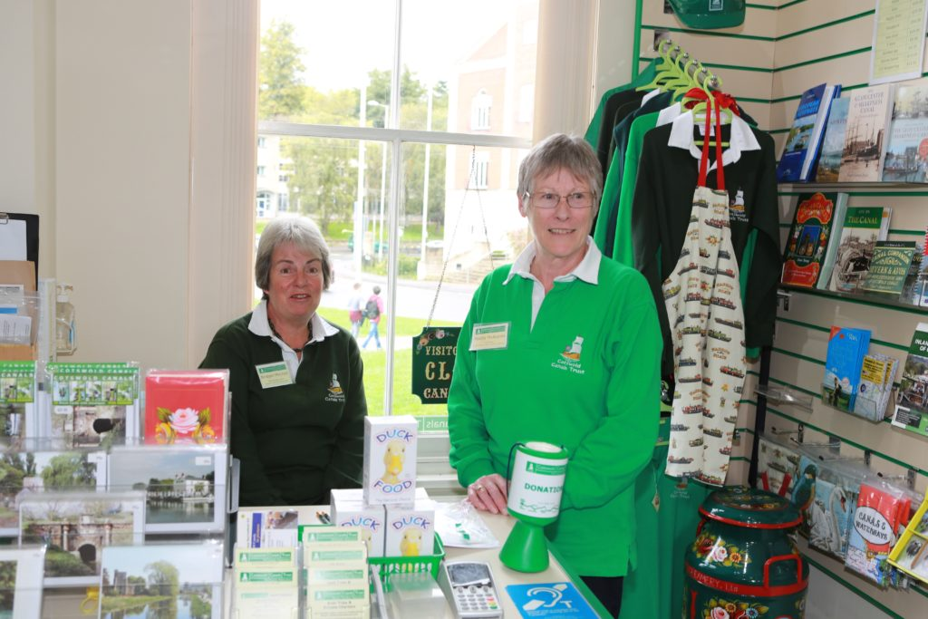Two volunteers pictured in the Cotswold Canals Trust shop.